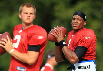 SPARTANBURG, SC - AUGUST 03:  Teammates Jimmy Clausen #2 and Cam Newton #1 of the Carolina Panthers compete in a workout during training camp at Wofford College on August 3, 2011 in Spartanburg, South Carolina.  (Photo by Streeter Lecka/Getty Images)