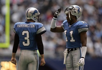 IRVING, TX - NOVEMBER 20:  Roy Williams #11 and Joey Harrington #3 of the Detroit Lions share a few words during a break in play against the Dallas Cowboys during their game on November 20, 2005 at Texas Stadium in Irving, Texas.  The Cowboys defeated the