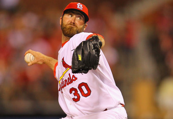 ST. LOUIS, MO - JULY 8: Reliever Jason Motte #30 of the St. Louis Cardinals pitches against the Arizona Diamondbacks at Busch Stadium on July 8, 2011 in St. Louis, Missouri.  (Photo by Dilip Vishwanat/Getty Images)