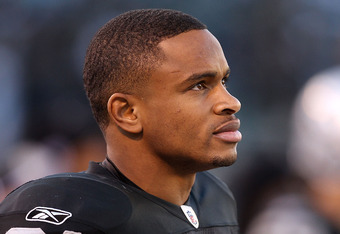 OAKLAND, CA - NOVEMBER 28:  Nnamdi Asomugha #21 of the Oakland Raiders stands on the sidelines during the closing minutes of their loss to the Miami Dolphins at Oakland-Alameda County Coliseum on November 28, 2010 in Oakland, California.  (Photo by Ezra S