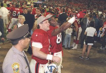 29 Jan 1995:  Quarterback Steve Young (next to policeman ) with  wide receiver Jerry Rice at his left of the San Francisco 49ers greet the crowd after victory over the San Diego Chargers at Super Bowl XXIX at the Joe Robbie Stadium in Miami, Florida.  The