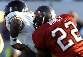 1 Aug 1998:  Quarterback Kordell Stewart #10 of the Pittsburgh Steelers being tackled by Charles Mincy #22 during the Pro Football Hall of Fame Game against the Tampa Bay Buccaneers at the Fawcett Stadium in Canton, Ohio. The Buccaneers defeated the Steel