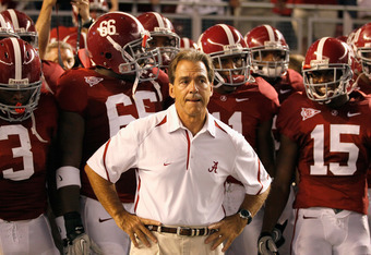 TUSCALOOSA, AL - OCTOBER 02:  Head coach Nick Saban of the Alabama Crimson Tide leads his team onto the field to face the Florida Gators at Bryant-Denny Stadium on October 2, 2010 in Tuscaloosa, Alabama.  (Photo by Kevin C. Cox/Getty Images)