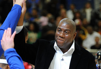 February 12, 2010: Magic Johnson slaps hands in Cowboys Stadium.  He was a celebrity coach during All-Star Weekend.