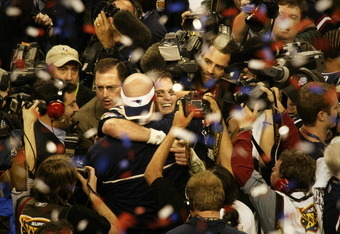 HOUSTON, TX - FEBRUARY 1:  Super Bowl MVP Tom Brady #12 of the New England Patriots celebrates after defeating the Carolina Panthers in Super Bowl XXXVIII at Reliant Stadium on February 1, 2004 in Houston, Texas. The Patriots defeated the Panthers 32-29.