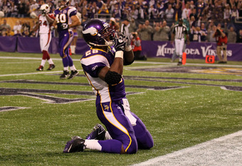 MINNEAPOLIS - NOVEMBER 7: Running back Adrian Peterson #28 of the Minnesota Vikings celebrates after his 12 yard touchdown reception in the second quarter against the Arizona Cardinals at Hubert H. Humphrey Metrodome on November 7, 2010 in Minneapolis, Mi
