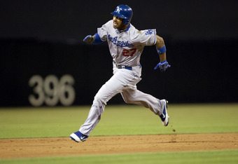 SAN DIEGO, CA - AUGUST 1: Matt Kemp #27 of the Los Angeles Dodgers runs from second to third base during the game against the San Diego Padres at Petco Park on August 1, 2011 in San Diego, California. (Photo by Kent C. Horner/Getty Images)