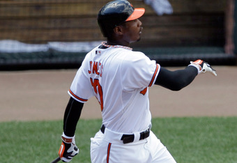 BALTIMORE, MD - JULY 17:  Adam Jones #10 of the Baltimore Orioles hits a solo home run against the Cleveland Indians during the second inning at Oriole Park at Camden Yards on July 17, 2011 in Baltimore, Maryland.  (Photo by Rob Carr/Getty Images)