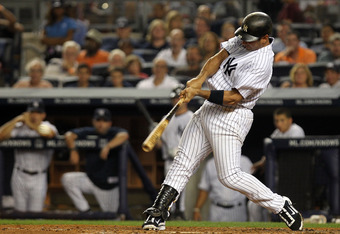 NEW YORK, NY - JULY 29: Jorge Posada #20 of the New York Yankees hits a single in the third inning against the Baltimore Orioles on July 29, 2011 at Yankee Stadium in the Bronx borough of New York City.  (Photo by Nick Laham/Getty Images)