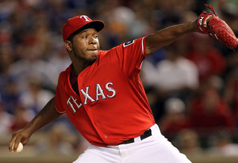 ARLINGTON, TX - JULY 26:  Neftali Feliz #30 of the Texas Rangers throws against the Minnesota Twins at Rangers Ballpark in Arlington on July 26, 2011 in Arlington, Texas.  (Photo by Ronald Martinez/Getty Images)