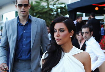 MONTE CARLO, MONACO - MAY 27:  Kim Kardashian and Kris Humphries attend the Amber Fashion Show held at the Meridien Beach Plaza on May 27, 2011 in Monte Carlo, Monaco.  (Photo by Mark Thompson/Getty Images)