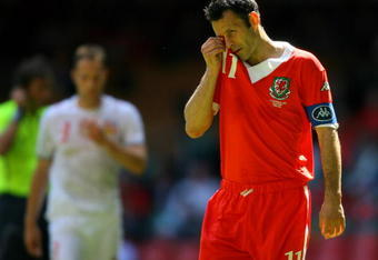 CARDIFF, UNITED KINGDOM - JUNE 02:  Wales captain Ryan Giggs takes a breather during the Euro 2008 Group D Qualifying Match between Wales and Czech Republic at the Millennium Stadium on June 2, 2007 in Cardiff, Wales.  (Photo by Stu Forster/Getty Images)
