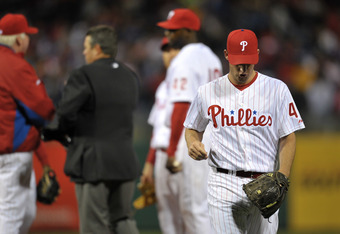 PHILADELPHIA, PA - APRIL 15: Starting pitcher Roy Oswalt #44 of the Philadelphia Phillies walks from the mound after getting injured during the game against the Florida Marlins at Citizens Bank Park on April 15, 2011 in Philadelphia, Pennsylvania. The Mar