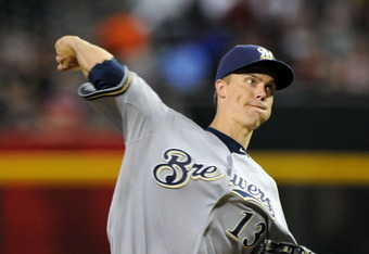 PHOENIX, AZ - JULY 21:  Starting pitcher Zach Greinke #13 of the Milwaukee Brewers delivers a pitch against the Arizona Diamondbacks at Chase Field on July 21, 2011 in Phoenix, Arizona.  (Photo by Norm Hall/Getty Images)