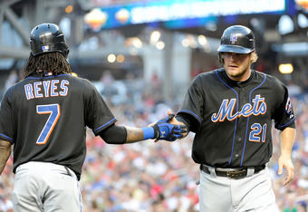 WASHINGTON, DC - JULY 29:  Lucas Duda #21 of the New York Mets celebrates with teammate Jose Reyes #7 after scoring in the fourth inning against the Washington Nationals at Nationals Park on July 29, 2011 in Washington, DC.  (Photo by Greg Fiume/Getty Ima