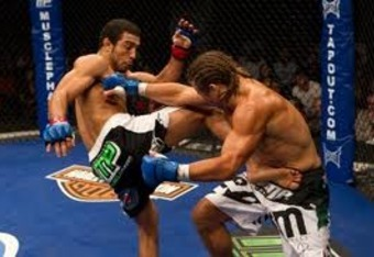 Jose Aldo brutalizing Urijah Faber's mid-section