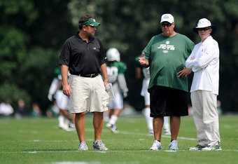 FLORHAM PARK, NJ - AUGUST 07:  General manager Mike Tannenbaum of the New York Jets (L) talks with Head coach Rex Ryan and owner Woody Johnson during the afternoon practice at NY Jets Practice Facility on August 7, 2011 in Florham Park, New Jersey.  (Phot