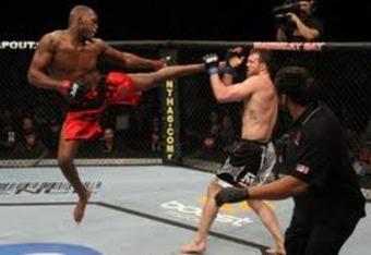 Jon Jones executing a flying leg kick against Ryan Bader