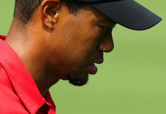 AKRON, OH - AUGUST 07:  Tiger Woods looks on from the second tee during the final round of the World Golf Championships-Bridgestone Invitational on the South Course at Firestone Country Club on August 7, 2011 in Akron, Ohio.  (Photo by Andy Lyons/Getty Im