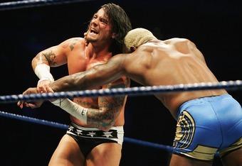 CM Punk works over Shelton Benjamins arm in Sydney, Australia in 2008.
