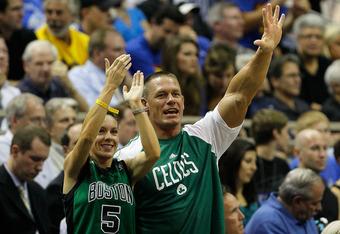 Giant hypocrite John Cena cheers on the Boston Celtics.
