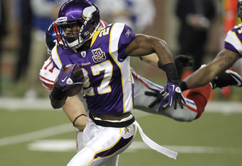 DETROIT, MI - DECEMBER 13: Lorenzo Booker #27 of the Minnesota Vikings tries to get around the tackle during a kick off return of Dave Tollefson #71 of the New York Giants at Ford Field on December 13, 2010 in Detroit, Michigan.  (Photo by Gregory Shamus/