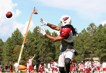 FLAGSTAFF, AZ - AUGUST 04:  Wide receiver Larry Fitzgerald #11 of the Arizona Cardinals catches a reception during the team training camp at Northern Arizona University on August 4, 2011 in Flagstaff, Arizona.  (Photo by Christian Petersen/Getty Images)