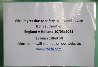 LONDON, ENGLAND - AUGUST 09:  A sign stating the England v Netherlands game is called off at Wembley Stadium as the England v Netherlands game is called off at Wembley Stadium following a night of rioting on August 9, 2011 in London, England. Widespread l