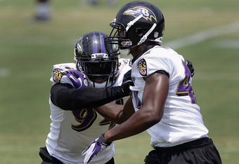 OWINGS MILLS, MD - JULY 29: Sergio Kindle #94 (L) and Chavis Williams #47 (R) block each other during drills at training camp on July 29, 2011 in Owings Mills, Maryland.  (Photo by Rob Carr/Getty Images)
