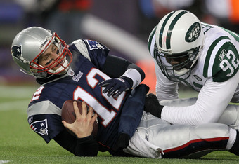 The only time you will see Shaun Ellis on top of Tom Brady this season will be in practice.