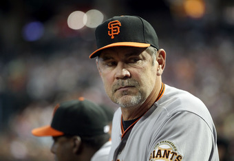 PHOENIX, AZ - APRIL 17:  Manager Bruce Bochy of the San Francisco Giants watches from the dugout during the Major League Baseball game against the Arizona Diamondbacks at Chase Field on April 17, 2011 in Phoenix, Arizona.  (Photo by Christian Petersen/Get