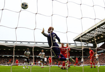 LIVERPOOL, ENGLAND - MAY 15:  Goalkeeper Pepe Reina of Liverpool dives in vain as the shot from Rafael Van der Vaart of Spurs flies into the net for the opening goal during the Barclays Premier League match between Liverpool and Tottenham Hotspur at Anfie