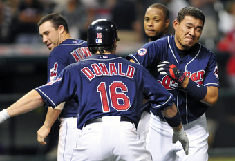 CLEVELAND, OH - AUGUST 10: Jason Donald #16 celebrates with Kosuke Fukudome #1 of the Cleveland Indians after Fukadome was hit by a pitch with the bases loaded to score the winning run to defeat the Detroit Tigers 3-2 in the fourteenth inning at Progressi