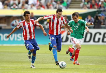 OAKLAND, CA - MARCH 26:  Paul Aguilar of Mexico and Antolin Alcaraz and Marcelo Estigarribia of Paraguay go for the ball during their international friendly match at Oakland-Alameda County Coliseum on March 26, 2011 in Oakland, California.  (Photo by Ezra