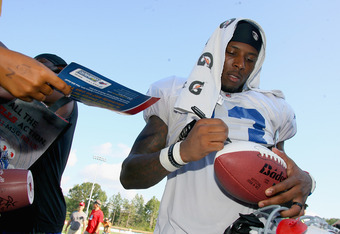 PITTSFORD, NY - AUGUST 08:  Stevie Johnson #13 of the Buffalo Bills signs autographs during the Buffalo Bills Training Camp at St. John Fisher College on August 8, 2011 in Pittsford, New York.  (Photo by Rick Stewart/Getty Images)