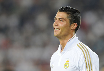 GUANGZHOU, CHINA - AUGUST 03:  Cristiano Ronaldo of Real Madrid smiles  during the pre-season friendly match between Guangzhou Evergrande and Real Madrid at the Tianhe Stadium on August 3, 2011 in Guangzhou, China. (Photo by Victor Fraile/Getty Images)