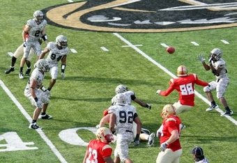 Army's Donovan Travis after interception latterals to Jordan Trible who runs back for TD in 2010 vs VMI . (K. Kraetzer)