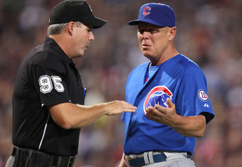ATLANTA, GA - AUGUST 12:  Manager Mike Quade #8 of the Chicago Cubs argues with home plate umpire Tim Timmons #95 after pitcher Carlos Zambrano is ejected during the game against the Atlanta Braves at Turner Field on August 12, 2011 in Atlanta, Georgia.