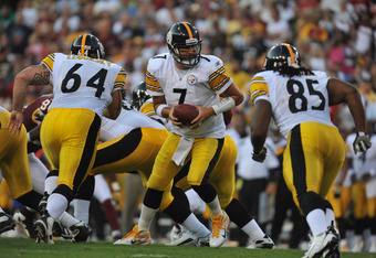 LANDOVER, MD - AUGUST 12:  Ben Roethlisberger #7 of the Pittsburgh Steelers hands off against the Washington Redskins at FedExField on August 12, 2011 in Landover, Maryland. The Redskins defeated the Steelers 16-7 at the half. (Photo by Larry French/Getty