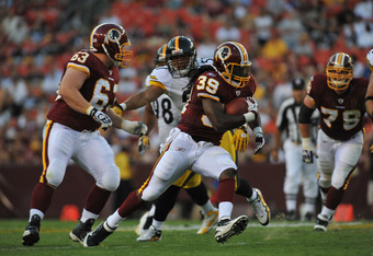 LANDOVER, MD - AUGUST 12:  Tim Hightower #39 of the Washington Redskins runs the ball against the Pittsburgh Steelers  at FedExField on August 12, 2011 in Landover, Maryland. The Redskins defeated the Steelers 16-7. (Photo by Larry French/Getty Images)