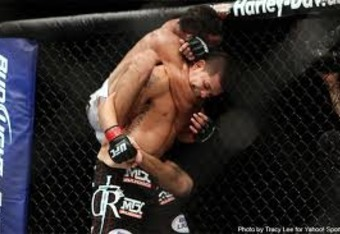 Charles Oliveira securing a standing rear-naked choke