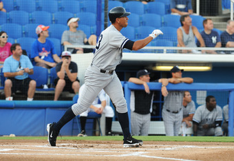 DUNEDIN, FL - AUGUST 12:  Designated hitter Alex Rodriguez of the Tampa Yankees homers in his first at bat against the Dunedin Blue Jays  August 12, 2011 at Florida Auto Exchange Stadium in Dunedin, Florida. Rodriguez played during a rehabilitation assign