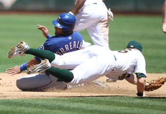 OAKLAND, CA - AUGUST 13:  Eric Sogard #36 of the Oakland Athletics tags out Yorvit Torrealba #8 of the Texas Rangers at O.co Coliseum on August 13, 2011 in Oakland, California.  (Photo by Jed Jacobsohn/Getty Images)