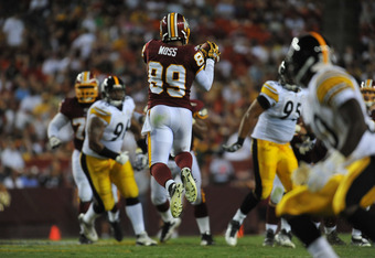 LANDOVER, MD - AUGUST 12:  Santana Moss #89 of the Washington Redskins makes a catch against the Pittsburgh Steelers  at FedExField on August 12, 2011 in Landover, Maryland. The Redskins defeated the Steelers 16-7. (Photo by Larry French/Getty Images)
