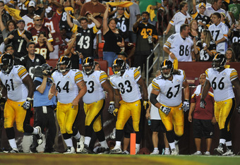 LANDOVER, MD - AUGUST 12:  The Pittsburgh Steelers celebrate a touchdown against the Washington Redskins at FedExField on August 12, 2011 in Landover, Maryland. The Redskins defeated the Steelers 16-7 at the half. (Photo by Larry French/Getty Images)