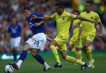 LIVERPOOL, ENGLAND - AUGUST 05:  Ross Barkley of Everton in action with Bruno of Villarreal during the pre season friendly match between Everton and Villarreal  at Goodison Park on August 5, 2011 in Liverpool, England.  (Photo by Clive Brunskill/Getty Ima