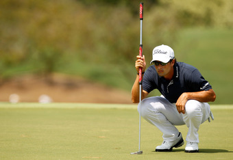 JOHNS CREEK, GA - AUGUST 14:  Adam Scott of Australia lines up a putt during the final round of the 93rd PGA Championship at the Atlanta Athletic Club on August 14, 2011 in Johns Creek, Georgia.  (Photo by Mike Ehrmann/Getty Images)