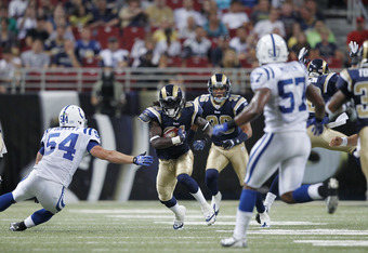 ST. LOUIS, MO - AUGUST 13: Mardy Gilyard #81 of the St. Louis Rams looks for room to run on a punt return against the Indianapolis Colts during the NFL preseason game at Edward Jones Dome on August 13, 2011 in St. Louis, Missouri. The Rams defeated the Co
