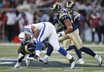 ST. LOUIS, MO - AUGUST 13: Donald Brown #31 of the Indianapolis Colts gets tackled while running the ball against the St. Louis Rams during the NFL preseason game at Edward Jones Dome on August 13, 2011 in St. Louis, Missouri. The Rams defeated the Colts