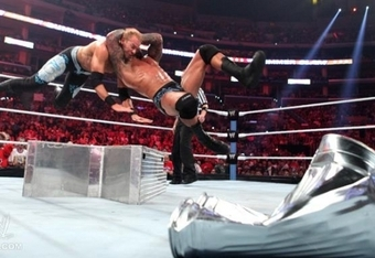 Randy Orton hits Christian with an awesome RKO that ends the match.